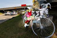 A ghost bike sits at the south east corner of Belt Line Road and Interstate 20 where Calvin Middleton of Cedar Hill was killed on his early morning ride in Grand Prairie.(Nathan Hunsinger/Staff Photographer)