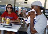 Cleveland Indians fan Herbert Littlejohn of Saginaw, Texas, wipes his face with a wet towel. He and his wife, Carina Littlejohn, sought relief in a shady spot during Sunday's game at Globe Life Park in Arlington. (Tom Fox/Staff Photographer)