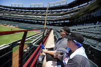 Texas Rangers fans Paige Baucom (front) and Patrick Rovell of Lone Oak try to keep cool before Sunday's game at Globe Life Park in Arlington.(Tom Fox/Staff Photographer)