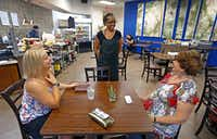 Fana Yohannes, center, talks with her friends Angela Dennison, left, and Beth Basile, who both showed up for a pop-up lunch at Carver Park.(Jae S. Lee/Staff Photographer)