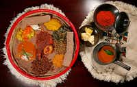"<p>A traditional Ethiopian platter of dishes, with Doro We't in the center, served atop <span style=""font-size: 1em; background-color: transparent;"">injera bread.</span></p>(Jae S. Lee/Staff Photographer)"