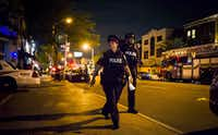 Police secure a perimeter around the scene of a mass shooting in Toronto on Monday.(Christopher Katsarov/AP)