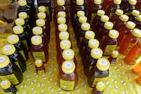Warne Bee Farm in Anna makes several flavored raw, unfiltered honeys and sells at West Plano Farmers Market.(Kim Pierce/Special Contributor)