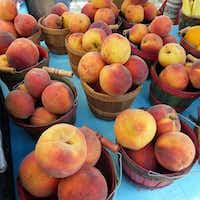 La Esperanza had Texas peaches on its table last Saturday at the West Plano Farmers Market.(Kim Pierce/Special Contributor)