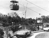 The Happy Motoring Speedway was a popular attraction at Six Flags as Patrons could slip behind the wheel of a then-futuristic, sleek sports car and drive around a modern highway that didn't involve honking  or passing cars as they could only ride in the middle lane. (The Dallas Morning News/Clint Grant)