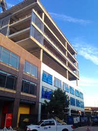 The new Luminary Building is under construction on Houston Street in downtown Dallas' West End.(Steve Brown)