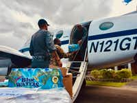<p>Resilience Global pilot Captain David Sexton and Pathfinder Medic Peter Barrow help unload vital aid supplies at Canefield Airport, Dominica. Following Hurricane Maria, the Resilience Global King Air C90 (N121GT) was one of the few aircraft delivering life-saving cargo to the island, as well as flying in and out key personnel such as doctors, pharmacists, NGO respondents, government officials and dignitaries, and the media.</p>(Resilience Global)