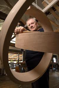 Wood sculptor Rick Maxwell poses with an unfinished sculpture. (Jeffrey McWhorter/Special Contributor)
