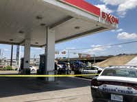 Dallas police cordoned off the parking lot at the Exxon gas station near where a man shot at three vehicles, injuring two people.(Samantha J. Gross/Staff)
