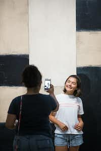 "Hermalinda Idrogo, left, takes a photo of Eva Idrogo, 12, in front of ""Catherine, 1993"" by Sean Scully at The Modern Art Museum of Fort Worth.(Ashley Landis/Staff Photographer)"