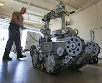 Garland Police Officer Robby Shreves operates the department's bomb robot on Tuesday, May 15, 2018. (Louis DeLuca/Staff Photographer)