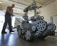 Garland Police Officer Robby Shreves operates the department's bomb robot on Tuesday, May 15, 2018.(Louis DeLuca/Staff Photographer)