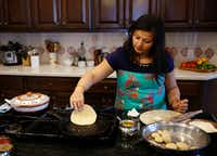 Sapna Punjabi-Gupta flips a roti at her home in Irving.(Vernon Bryant/Staff Photographer)