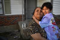 Rosemary Espinosa held granddaughter Cicilia Valdez in  January 2016 in Dallas. Rosemary is the mother of Marisol Espinosa and Cicilia is Marisol's daughter. Marisol went missing Dec. 29, 2015. (File Photo/Staff )