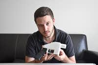 Cody Wilson with a 3-D printed gun.(Lorenza Baroncelli/Defense Distributed)