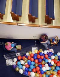 Pam Symank of Texas Balloon Arches and one of her workers, Brent Turner, blow up thousands of balloons Wednesday in advance of First Baptist Dallas' 150th anniversary celebration at the  downtown Dallas church.(Tom Fox/Staff Photographer)