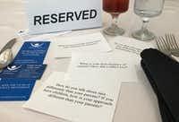 "Project Unity and the Dallas Bar Association's ""Together We Dine"" luncheon uses question cue cards to initiate open conversations about racial unity between guests, so they can listen and learn from each other.(Briana Lao/Staff)"
