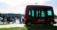 Passengers can ride a free driverless shuttle, called Milo, in Arlington's entertainment district. The shuttle service operates on private roads, but the city is considering expanding it to public ones. (Ashley Landis/Staff Photographer)