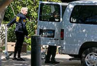 FBI agents load boxes into a van while the federal agents raid the Medoc Health Services company in Dallas, Wednesday, May 9, 2018. (Jae S. Lee/Staff Photographer)