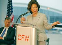Secretary of Transportation Elaine Chao talked about the airport improvement grants as she presented a letter of intent for DFW Airport infrastructure improvements, including end-around taxiways, during a news conference at the airport on Friday. (Photo pool/Louis DeLuca/The Dallas Morning News)(Louis DeLuca/Staff Photographer)
