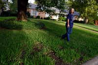 Mary Jane Mackenna, 68, points to a patch of grass where Atmos Energy dug into her front yard to replace a leaking gas line in March of this year. Her neighborhood is part of an expanded area due to have its gas lines replaced by 2019, because Atmos Energy found so many leaks.(Ben Torres/Special Contributor)