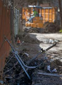 Old steel gas lines were replaced in an alley between Espanola and Fontana drives in northwest Dallas earlier this year as part of a large system replacement by Atmos Energy that affected 2,800 homes.(Jae S. Lee/Staff Photographer)