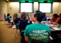 Local high school teachers with the assistance of Fidelity Investments volunteers attend a financial literacy training program led by Fidelity at their corporate offices on Wednesday in Westlake.  (Tom Fox/The Dallas Morning News)(Tom Fox/Staff Photographer)