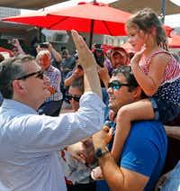 <p>After getting a haircut, Cruz held a large rally at Ferris Wheelers Backyard and BBQ in the Dallas Design District. (Louis DeLuca/Staff Photographer) </p>
