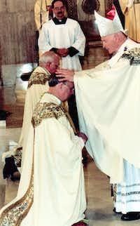 Feb. 11, 2002: Cardinal Theodore E. McCarrick lays his hands on Bishop Kevin Farrell during Bishop Farrell's ordination to the episcopacy. (Archdiocese of Washington)