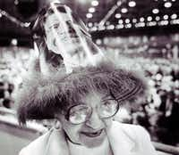 Elaine Thomas of Cleveland wears a festive hat on the convention floor. (David Butow )