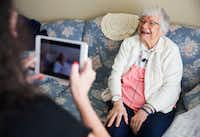 Irene Skurla is interviewed by Vibrant Life Director Lynn Brink using the OneDay app for senior citizens on July 24 at The Village at Mapleshade in Plano. (Ashley Landis/Staff Photographer)