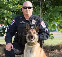 "<p>The&nbsp;<span style=""font-size: 1em; background-color: transparent;"">Baytown police K-9 that was stabbed in the face Monday pictured with his handler.</span></p>(Baytown Police Department)"