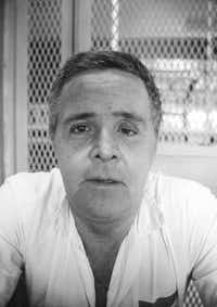 "This Oct. 10, 1990, file photo, shows convicted killer Henry Lee Lucas, on death row at Huntsville, Texas. Associated Press journalist Mike Graczyk, who witnessed and chronicled more than 400 executions as a criminal justice reporter in Texas, retired  July 31, 2018, after 45 years. Reflecting on Lucas, known as the ""one-eyed drifter,"" Graczyk said the inmate told him once that he took out his glass eye every night, placed it on a shelf in his cell and reminded new cell partners that if they considered stealing something from him, ""I've got my eye on you."" (Michael Graczyk/The Associated Press)"