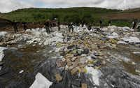 Ecuadorian authorities seize a load of cocaine headed for the Galapagos Islands, a major transit point for drug traffickers. (Arnulfo Franco/The Associated Press)