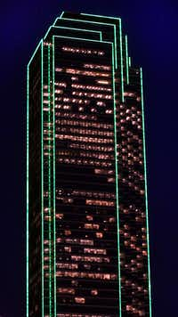 For most of its more than 30 years, the 72-story Bank of America Plaza tower has been outlined in green lights.(File Photo/The Dallas Morning News)