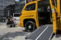 "<p><span style=""font-size: 1em; background-color: transparent;"">In this July 12, 2015 file photo, a woman in a wheelchair rolls past a proposed taxi ramp designed for people with disabilities at the first annual Disability Pride Parade in New York City. The parade calls attention to the rights of people with disabilities and coincides with the 25th anniversary of the Americans with Disabilities Act.</span></p>(Stephanie Keith/Getty Images)"