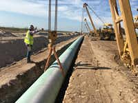 A shortage of crude oil and natural gas pipeline capacity is squeezing Permian Basin drillers. Kinder Morgan's $1.75 billion Gulf Coast Express natural gas pipeline is under construction now and will link the Permian Basin with the Texas Gulf Coast. Despite President Donald Trump's new steel tariffs, that project and others in the Permian Basin are still going forward.(Kinder Morgan)