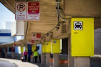 A sign designating the taxi cab waiting area is posted at Terminal A at DFW International Airport on Wednesday.(Ashley Landis/Staff Photographer)