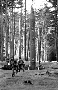 "Soldiers of the East German army at a launching platform with a rocket during a military exercise of the air defense forces in 1983, the year of NATO's ""Operation Able Archer '83"" simulation exercise. (Reinhard Kaufhold/picture-alliance/dpa/AP Images)"