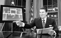 "<p><span style=""font-size: 1em; background-color: transparent;"">President Ronald Reagan addresses the nation on television March 23, 1983, from Washington, D.C., in support of his proposed defense budget.</span></p>(Dennis Cook/The Associated Press)"