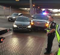 This photo provided by Ronnie Hill's attorney shows the scene after Ezekiel Elliott's GMC truck collided with Hill's BMW at Gaylord and Dallas parkways in Frisco on Jan. 11, 2017.