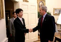 <p>President George W. Bush welcomed Kang Chol-hwan, author of<i> The Aquariums of Pyongyang: Ten Years in the North Korean Gulag,</i> to the White House on June 13, 2005. Kang and his family spent 10 years in a concentration camp after his grandfather was accused of treason by the Kim regime.</p>(The White House/Eric Draper)