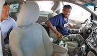 Taxi driver Ahmed Indris of Dallas picks up a fare at Terminal D at DFW Airport.(Louis DeLuca/Staff Photographer)