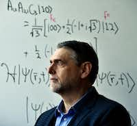 Some of the nation's most advanced work in quantum computing is being done in Texas, including at Southern Methodist University under the guidance of  professor Mitch Thornton, shown in the university's Caruth Hall near a wall filled with quantum equations.(Ben Torres/Special Contributor)