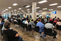 Long lines form at the Texas Department of Public Safety Driver License Mega Center in Carrollton, on Friday, August 3, 2018.(Samantha J. Gross/DMN Staff)