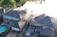 "<p><span style=""font-size: 1em; background-color: transparent;"">Heavy smoke and fire were showing from two homes in the 8000 block of Burleigh Street when firefighters arrived.</span></p>(<p>Rodney Livermore, <span style=""font-size: 1em; background-color: transparent;"">1stInspect.biz</span></p>)"