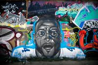 Artist Trey Wilder painted a mural including Dallas Cowboys quarterback Dak Prescott on one of the Fabrication Yard graffiti walls in West Dallas, Saturday, August 4, 2018. The face appears to be a morph between the Get Out movie character and the Cowboys player. (Tom Fox/Staff Photographer)
