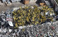 "<p><span style=""font-size: 1em; background-color: transparent;"">Hundreds of yellow Ofo rental bikes that once populated downtown Dallas sidewalks are now in a heap at CMC Recycling's facility on Good Latimer Expressway.</span></p>(Vernon Bryant/Staff Photographer)"