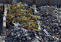 Hundreds of Ofo rental bikes were found at CMC Recycling in Dallas on Aug. 6, 2018. (Vernon Bryant/Staff Photographer)