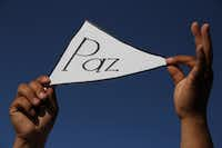 """A man held a sign reading """"peace"""" during the march for peace and against violence in Ciudad Juarez, Mexico, on June 23. At least 14 people were killed on that day in three different incidents in Juarez on the U.S. border. June and July each ended with 177 dead in the city.(HERIKA MARTINEZ/AFP/Getty Images)"""
